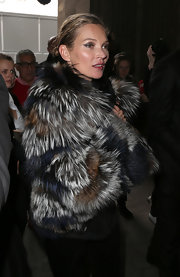 Kate Moss rocked a multi-colored fur coat while out for the Louis Vuitton fashion show in Paris.