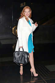 Jessica Chastain left 'Late Night with Jimmy Fallon' wearing a white Michael Kors coat over a blue ruffle dress.