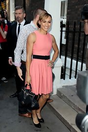 Jessica Ennis was ultra feminine during Athletics Night in a sleeveless pink dress with a flared skirt and a black belt.