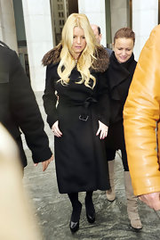 Jessica wears a black wool coat with a fur adorned collar while out in NYC.