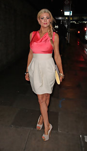 Nicola McLean wore a high-waisted skirt on top of her satin top to create the appearance of a two-tone dress at a night out in London.