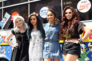 Jesy Nelson rocked a pair of cutoff shorts and a cropped tee while out with Little Mix in London.
