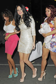 Tulisa Contostavlos wore a pair of sexy suede peep toe pumps while heading to a club in London.