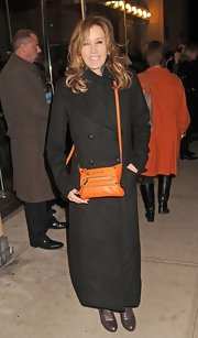 Felicity Huffman bundled up in this double-breasted ankle-length wool coat.