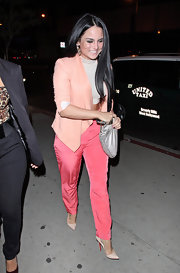 JoJo kept on-trend for spring in silky rose slacks and a pastel peach blazer.