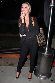 Joanna Krupa posed for the paparazzi in black satin peep toes.