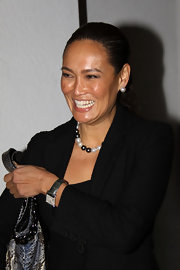 Tia Carrere finished off her look in classic style with a pair of pearl studs and a matching necklace.