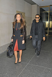 Chrissy Teigen's wool coat was a classic look with modern touches such as leather sleeves and pockets.