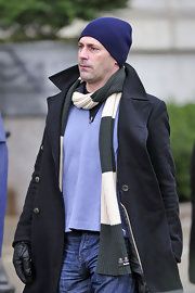 Jon wears a solid navy knit beanie to stay warm in New York.