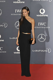 Thandie Newton wore an elegant one-shoulder black gown with a gold belt for the Laureus World Sports Awards.