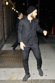 Jude Law looked ultra-slick in a pin-stripe suit and beanie for his appearance on 'Letterman.'