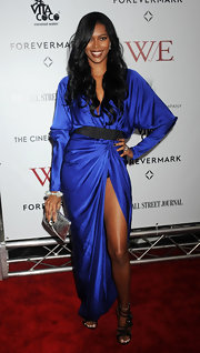 Jessica White wore a shining blue wrap-dress with a hip-high slit for the 'W.E.' NYC premiere.