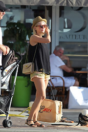 Julianne Hough carried a chain-strap shoulder bag while on vacation in St. Barths.