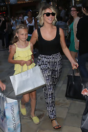Julianne Hough tucked in her loose black tank into this pair of printed pants for a classic and stylish look.