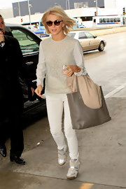 Julianne Hough kept her travel look monochromatic with this white blouse with floral design.