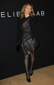 Julie wears a sleek abstract print dress to the Elie Saab couture show.
