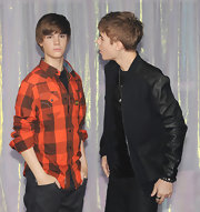 Even Justin Bieber's wax figure is fashionable! For its big debut at Madame Tussauds in London, wax Bieber wore a Stockton Piping Tetris check shirt ($150) at g-starstores.com.