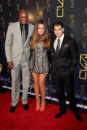 Lamar Odom wore a black-and-white striped tie with his gray suit during the opening of Scott Disick's restaurant.