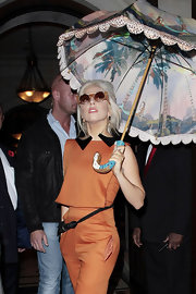 Lady Gaga accented her orange jumpsuit with a black rope belt while out in London.