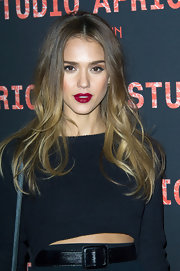 Jessica Alba opted for a deep red lip for her sexy evening look while out in Paris.