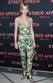 Leigh Lezark opted for a bright retro-inspired floral jumpsuit for her look at the Studio Africa party in Paris.