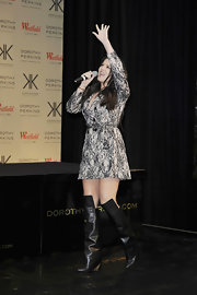 Khloe flaunted her long, lean legs in a pair of leather knee-high wedge boots.
