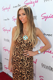 Giuliana added a turquoise pop to her leopard look wearing a large statement necklace.