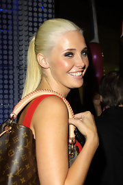 Karissa Shannon looked youthful and pretty with her sleek ponytail during a night out at Boa Steakhouse.