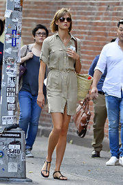 Karlie Kloss took a stroll in New York City wearing a pair of comfy flat T-strap sandals.