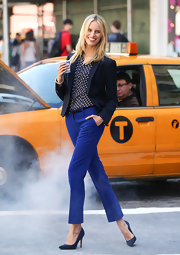 Karolina Kurkova made even a classic blazer look stylish by pairing it over a polka-dot blouse and electric blue pants.