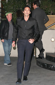 Adrian Brody paired a classic pair of navy slacks with a black button down for his evening look while out in LA.