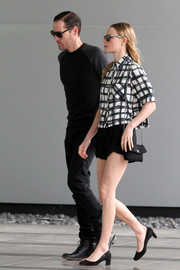 While sexy on the bottom half, Kate Bosworth kept it boyish up top in a black-and-white grid-print button-down.