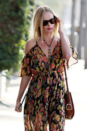 "Kate Bosworth added some flair to her day dress with her long ""Gypsy Queen"" necklace."