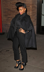 The always fashion forward Janelle Monae flexed her style prowess in black satin cut out boots. Matching cropped tuxedo pants and a cape complete the look.