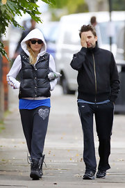 Kate Hudson was casual while out and about town with beau Matt Bellamy. The starlet wore a puffy vest paired with lace-up athletic sneakers.