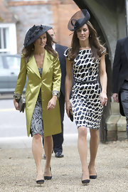 Pippa Middleton gave her wedding attire a sophisticated finish with black suede pumps.