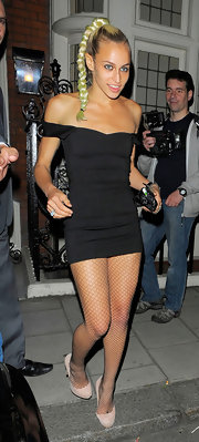 Alice rocked this minimalist black mini dress as she exited a party in London.