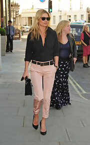 Kate Moss rocked these pale pink taffeta cigarette pants while out in London.