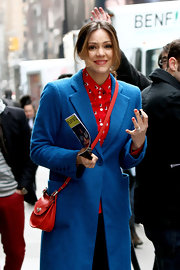 Katharine McPhee showed her love of color with a bright blue wool coat paired over a sailboat print blouse while on the set of 'Smash.'