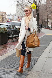 Katherine Heigl played with neutrals, pairing her cognac leather riding boots with a tan ostrich leather bag.