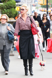 Katherine Heigl spent a day out in New York City looking smart in slouchy black boots, an A-line skirt, and a checkered button-down.