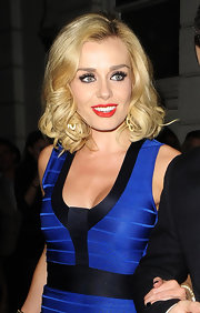 Katherine Jenkins wore her hair in subtle blond curls while out for the evening in London.