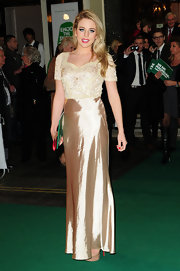 Lydia Bright was glowing in a golden evening gown with an embroidered bodice for the Macmillan Centenary Gala in London.