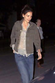 Katie Holmes looked decidedly low-key out in West Hollywood in an olive military style jacket and a sheer floral blouse.