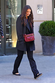 Katie Holmes added some color to her dark look with this red shoulder bag.