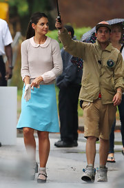 Katie's turquoise knee-length skirt added some color to her basic beige sweater.