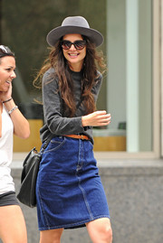 Katie Holmes was dressed down in a denim skirt and a crewneck sweater as she enjoyed a day out with her friend.