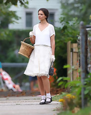 Katie's lacy skirt matched her sweet and feminine look on set of 'Miss Meadows.'