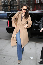 Katie wore a pair of 'Bette' high-rise jeans under her camel coat while out shopping in Manhattan.
