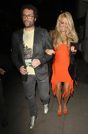 Katie Price wore a bright orange bandage dress with fun fringe for her night out in London.